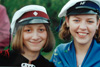 Studentahúgvan vinstru megin og HF húgvan høgru megin / Studenten til venstre og HF'eren til højre / The student with the red/black banded cap in the left and the girl with Higher Preparatory Examination with the black/blue banded cap in the right.